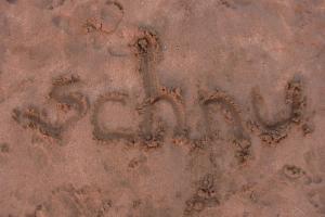Bali write in sand beach
